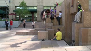 Three Guys Doing Parkour Flips