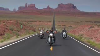Three Harley Motorcycles Drive Desert Highway