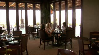 Three Ladies Have Lunch In Restaurant With Large Windows