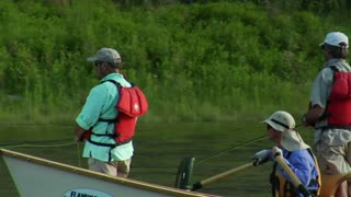 Three Men In Fly Fishing Drift Boat Pass Camera