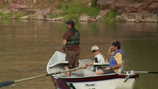 Three Men On Fly Fishing Drift Boat Relax On Water
