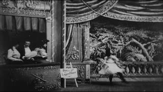 Three People Watching Young Girl Dance in Vaudeville Show