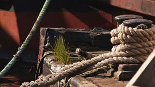 Tied Rope On Aged Boat Deck