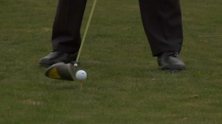 Tight Shot As Golfer Tees Off