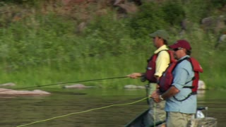 Tight Shot Of Two Men Fishing From Drift Boat