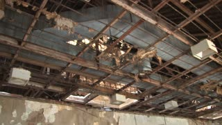 Tilt down duct and lattice work ceiling in abandoned room