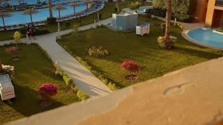 Tilt shot of exotic summer resort with beautiful exterior and landscape design