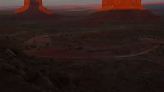 Tilt Up Shot Of Monument Valley At Sunset