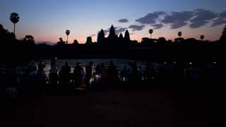 Time Lapse at Dawn over the Temple of Angkor Wat watched by many tourists, Siem Reap, Cambodia, South East Asia