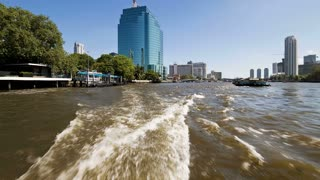 Time Lapse at speed along the Chao Phraya River passing Bangkoks Skyscrapers and Temples, Thailand, Asia