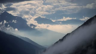 time lapse. beautiful landscape. alps rocks. fog clouds