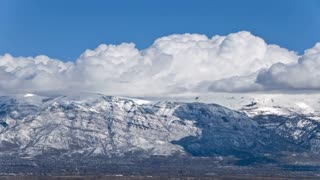 Time Lapse clouds over snowy mountains