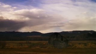 Time Lapse dry farm landscape with barn