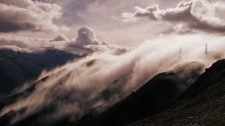 time lapse. fog raising. beautiful mountain landscape. foggy cloudy