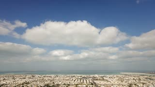 Time Lapse - High Angle Cloudscape on a beautiful day over the city of Dubai, Middle East, UAE