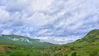 Time Lapse landscape with clouds over vibrant hills