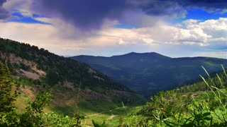 Time lapse lush green mountain landscape