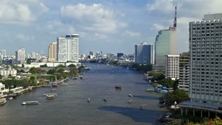 Time Lapse, Nautical Vessels along the Chao Phraya River passing Bangkoks Skyscrapers and Temples, Thailand, Asia