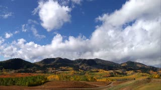 Time Lapse Of Clouds Over Autumn Mountains