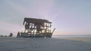 time lapse of rusty hull on pristine beach