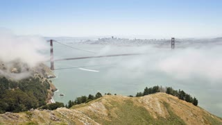 Time lapse of the famous sea fog identified as advection fog rolling in under the Golden Gate Bridge, San Francisco, California, United States of America