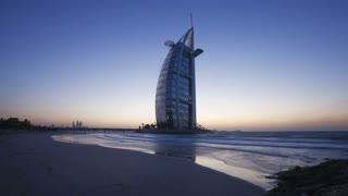 Time Lapse of the transition from dusk to night showing the illumination on the modern elegantly designed Burj Al Arab Hotel, Dubai, UAE
