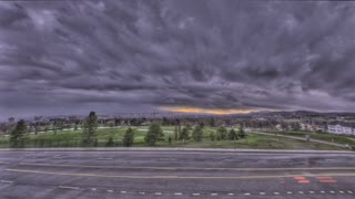 Time Lapse storm clouds over road