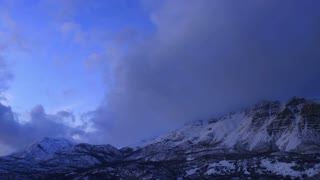 Time-lapse sunrise to sunset over mountains 1