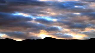 Time Lapse sunset clouds over mountain