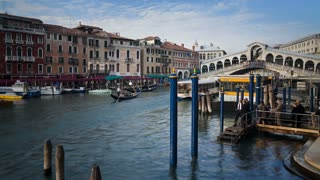 Time Lapse view looking north along the Grand Canal towards the Rialto Bridge in Venice Italy, Europe