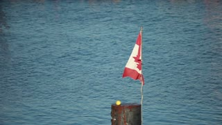 Time lapse water with Canadian flag