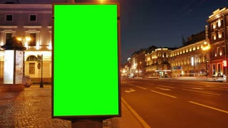 Timelaps. A Billboard with a Green Screen on a Busy Street