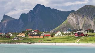 Timelapse beach Lofoten islands is an archipelago in the county of Nordland, Norway. Is known for a distinctive scenery with dramatic mountains and peaks, open sea and sheltered bays, beaches