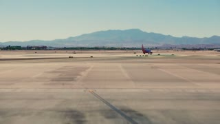 Timelapse Las Vegas Runway. Time lapse shot of commercial aircraft lining up for takeoff on a cloudy day at McCarran International Airport in Las Vegas, Nevada.