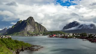 Timelapse Lofoten islands is an archipelago in the county of Nordland, Norway. Is known for a distinctive scenery with dramatic mountains and peaks, open sea and sheltered bays, beaches