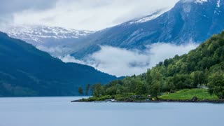 Timelapse - Morning on the lake Lovatnet, Norway - 4K ULTRA HD, 4096x2304.