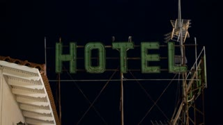 Timelapse of hotel banner with electric illumination blinking at night