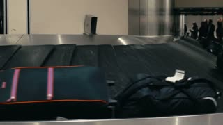 Timelapse of travel bags on working conveyor belt at the airport. Getting luggage after arrival