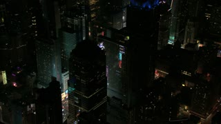 Times Square Lights Shining Through NYC Buildings