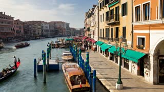 TLTour boats traveling on Grand Canal near Rialto Bridge, Venice, Veneto, Italy
