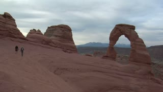 To Hikers Walk To Delicate Arch Arches National Park
