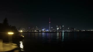 Toronto Ferry Ride at Night Time Lapse. POV time lapse shot, riding the night ferry to Toronto from Toronto Centre Island. Lightning can be seen behind the city skyline. Rendered in UltraHD 4K from high resolution stills.