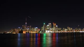 Toronto Night Skyline Timelapse 1. Toronto, Canada as seen from across the harbor at night, shot in long exposure time lapse.