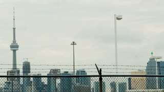Toronto Skyline Behind Barbed Wire Fence