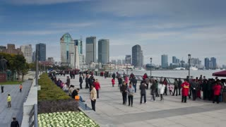 Tourists and local people on promenade, by the Huangpu waterfront, the Bund, Shanghai, China, Asia, T/Lapse