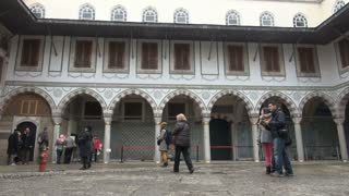 Tourists Exploring Topkapi Palace Courtyard