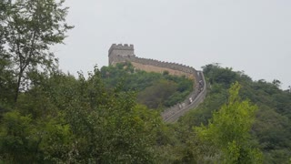 Tourists on Great Wall of China Through Foliage
