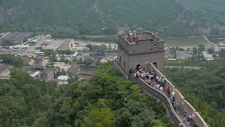 Tourists on Great Wall of China Tower Above Town