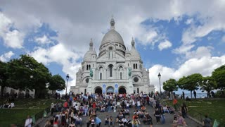 Tourists on the steps of Basilique du Sacre-Coeur in Paris, France with blue sky - T/Lapse