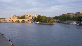 Tourists taking pleasure trips on the River Seine Paris in natural and illuminated light, Paris, France, Europe - T/Lapse